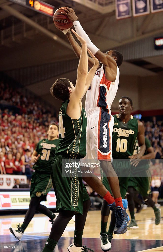 Gerard Coleman #0 of the Gonzaga Bulldogs goes to the hoop against defender David Cohn #34 of the Colorado State Rams during the game at McCarthey Athletic Center on November 11, 2013 in Spokane, Washington.