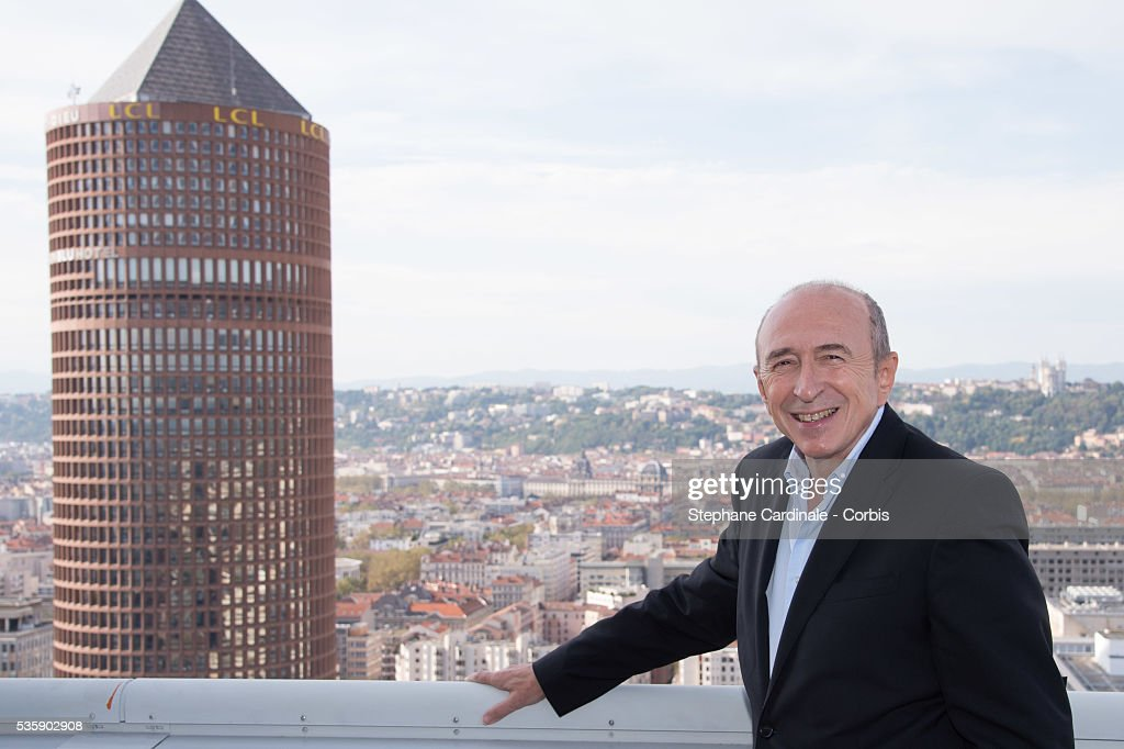 Gerard Collomb (Mayor of Lyon) poses in front of a general view of the City of Lyon, during the 5th Lumiere Film Festival, in Lyon.