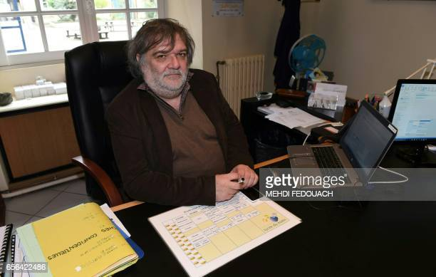 Gerard Coucharriere director of the Le Mirail High School poses in his office in Bordeaux southwestern France on March 20 2017 This nonstandard high...