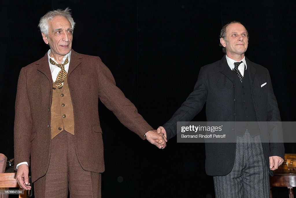 Gerard Darmon and Charles Berling acknowledge applause after the 200th performance of the play 'Inconnu A Cette Adresse' at Theatre Antoine on...