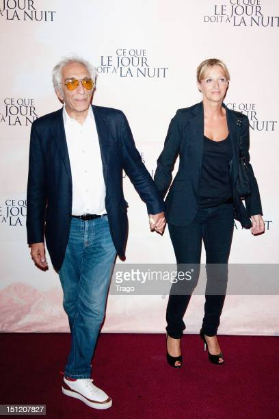 Gerard Darmon and Christine attend 'Ce Que Le Jour Doit A La Nuit' at Cinema Gaumont Marignan on September 3 2012 in Paris France
