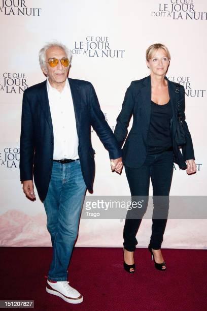 Gerard Darmon and Christine attend 'Ce Que Le Jour Doit A La Nuit' at Cinema Gaumont Marignan on September 3 2012 in Paris France