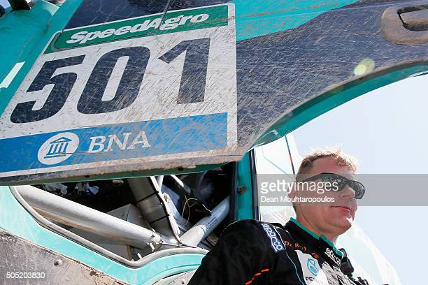 Gerard De Rooy of the Netherlands and with PETRONAS TEAM DE ROOY IVECO and in truck POWERSTAR IVECO celebrates winning the overall race as he arrives...