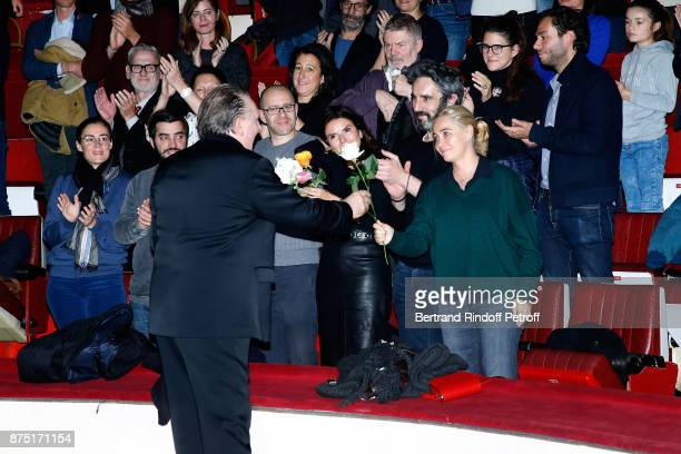 Gerard Depardieu acknowledges the applause of the audience and gives flowers to Emmanuelle Beart at the end of 'Depardieu Chante Barbara' at 'Le...