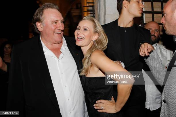 Gerard Depardieu and Angela Simon attend 'A Royal Affair' reception during the 74th Venice Film Festival at Pallazina G on September 5 2017 in Venice...