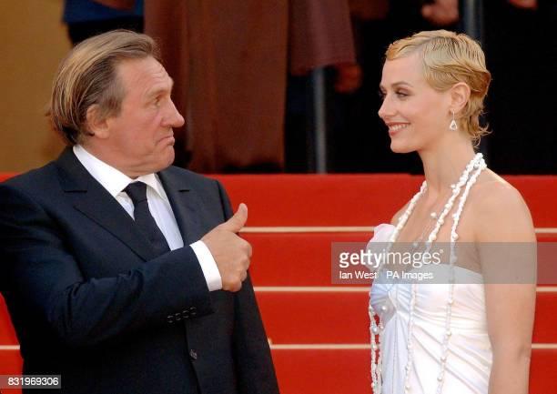 Gerard Depardieu and Cecile de France arrive for the premiere of Quand J'Etais Chanteur at the 59th Cannes Film Festival in Cannes France