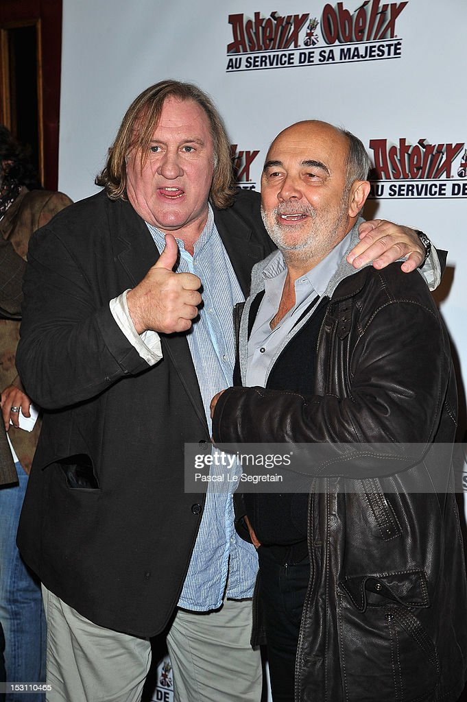 <a gi-track='captionPersonalityLinkClicked' href=/galleries/search?phrase=Gerard+Depardieu&family=editorial&specificpeople=207073 ng-click='$event.stopPropagation()'>Gerard Depardieu</a> and Gerard Jugnot (R) attend the 'Asterix & Obelix: Au Service De Sa Majeste' premiere at Le Grand Rex on September 30, 2012 in Paris, France.