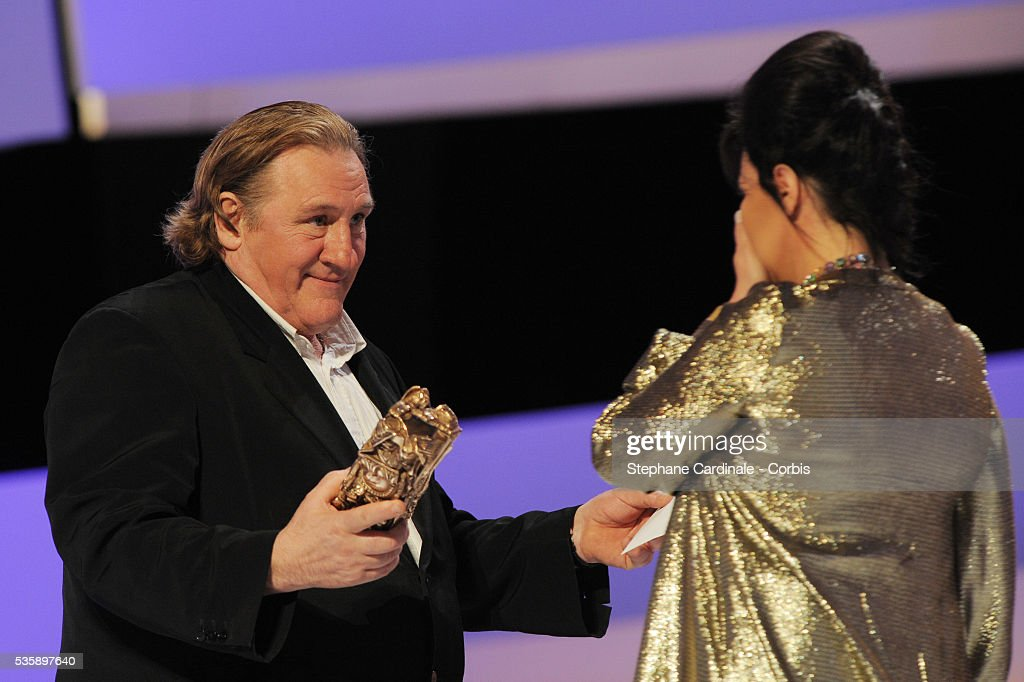 Gerard Depardieu and Isabelle Adajani on stage with her 'Best Actress' Cesar Award during the 35th Cesar awards ceremony, held at the Chatelet theater in Paris.