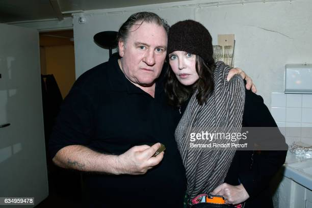 Gerard Depardieu and Isabelle Adjani pose Backstage after 'Gerard Depardieu sings Barbara accompanied on the piano of Barbara by Gerard Daguere who...