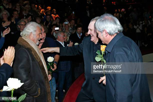 Gerard Depardieu and Pianist Gerard Daguerre acknowledge the applause of the audience and gives flowers to JeanPaul Belmondo and Antoine Dulery at...