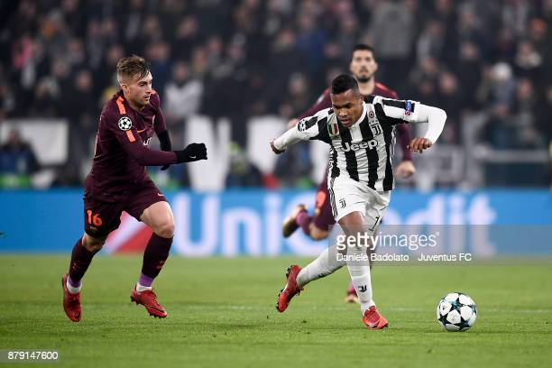 Gerard Deulofeu and Alex Sandro during the UEFA Champions League group D match between Juventus and FC Barcelona at Allianz Stadium on November 22...