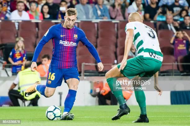 Gerard Deulofeu Lazaro of FC Barcelona fights for the ball with Alejandro Galvez Jimena of SD Eibar during the La Liga 201718 match between FC...