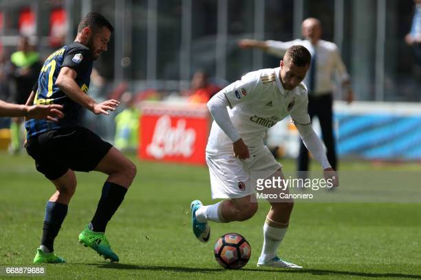 Gerard Deulofeu of Ac Milan and Antonio Candreva of Fc Internazionale in action during the Serie A match between Ac Milan and Internazionale Fc