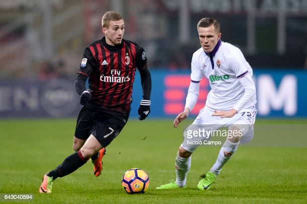Gerard Deulofeu of AC Milan and Josip Ilicic of ACF Fiorentina compete for the bal during the Serie A football match between AC Milan and ACF...