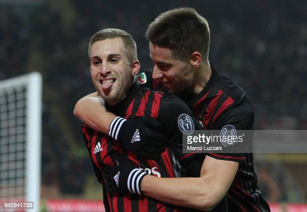 Gerard Deulofeu of AC Milan celebrates his goal with his teammate Mario Pasalic during the Serie A match between AC Milan and ACF Fiorentina at...