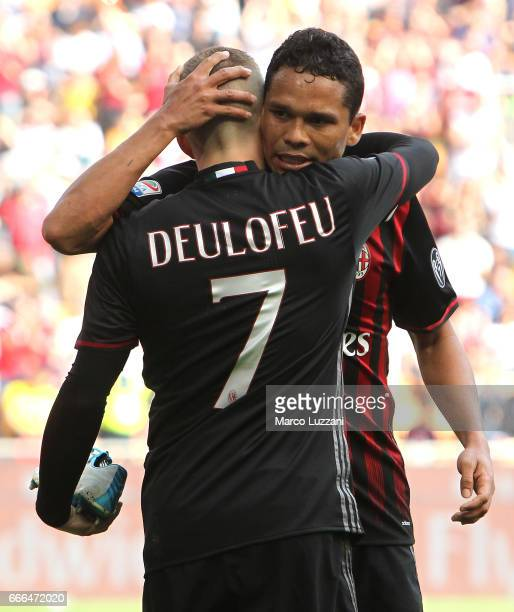 Gerard Deulofeu of AC Milan celebrates his goal with his teammate Carlos Bacca during the Serie A match between AC Milan and US Citta di Palermo at...