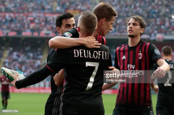 Gerard Deulofeu of AC Milan celebrates his goal with his teammate Mario Pasalic during the Serie A match between AC Milan and US Citta di Palermo at...