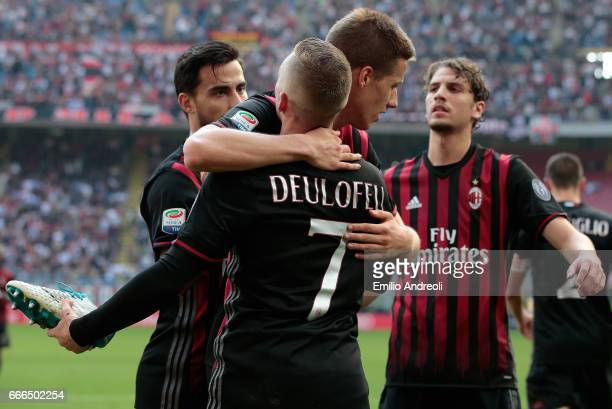 Gerard Deulofeu of AC Milan celebrates his goal with his teammate Mario Pasalic during the Serie A match between AC Milan and US Citta di Palermo at...