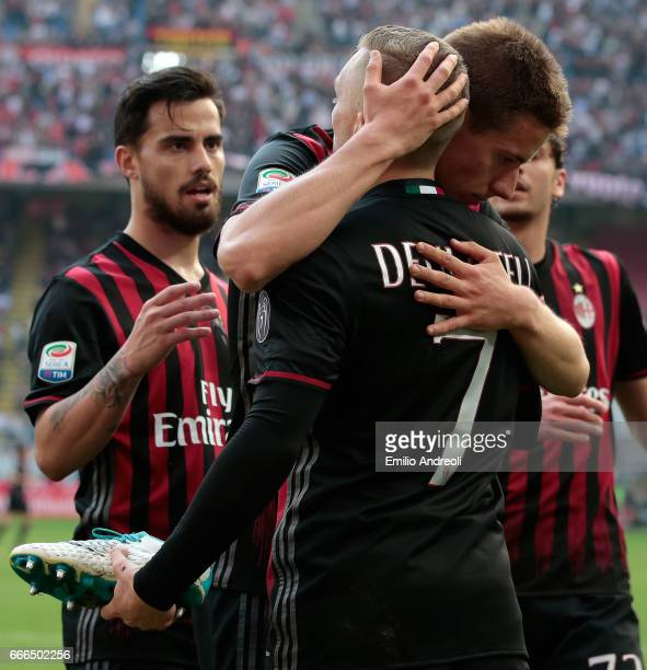 Gerard Deulofeu of AC Milan celebrates his goal with his teammate Mario Pasalic and Suso during the Serie A match between AC Milan and US Citta di...