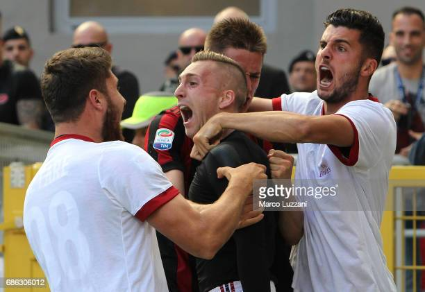 Gerard Deulofeu of AC Milan celebrates with his teammates after scoring the opening goal during the Serie A match between AC Milan and Bologna FC at...
