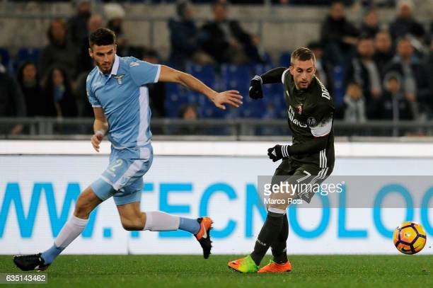 Gerard Deulofeu of Ac Milan compete for the ball with SS Lazio Wesley Hoedt during the Serie A match between SS Lazio and AC Milan at Stadio Olimpico...