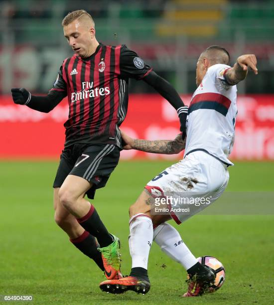 Gerard Deulofeu of AC Milan competes for the ball with Armando Izzo of Genoa CFC during the Serie A match between AC Milan and Genoa CFC at Stadio...