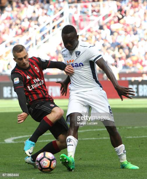 Gerard Deulofeu of AC Milan competes for the ball with Assane Diousse of Empoli FC during the Serie A match between AC Milan and Empoli FC at Stadio...