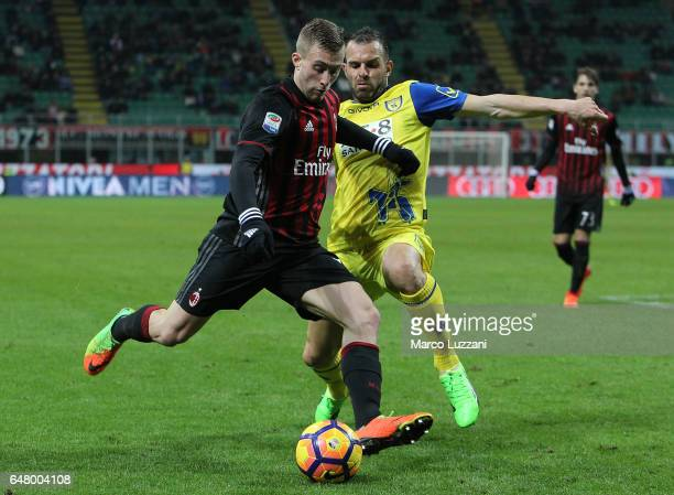 Gerard Deulofeu of AC Milan competes for the ball with Riccardo Meggiorini of AC ChievoVerona during the Serie A match between AC Milan and AC...