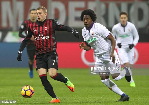 Gerard Deulofeu of AC Milan is challenged by Carlos Sanchez of ACF Fiorentina during the Serie A match between AC Milan and ACF Fiorentina at Stadio...