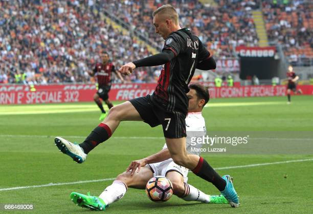 Gerard Deulofeu of AC Milan is challenged by Edoardo Goldaniga of US Citta di Palermo during the Serie A match between AC Milan and US Citta di...