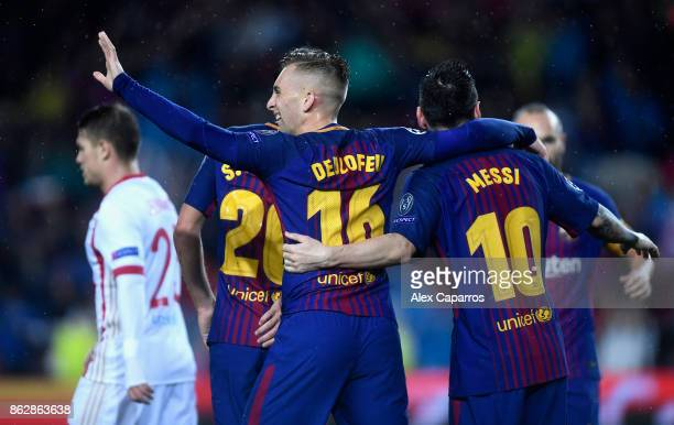 Gerard Deulofeu of Barcelona celebrates his sides first goal with Lionel Messi of Barcelona during the UEFA Champions League group D match between FC...