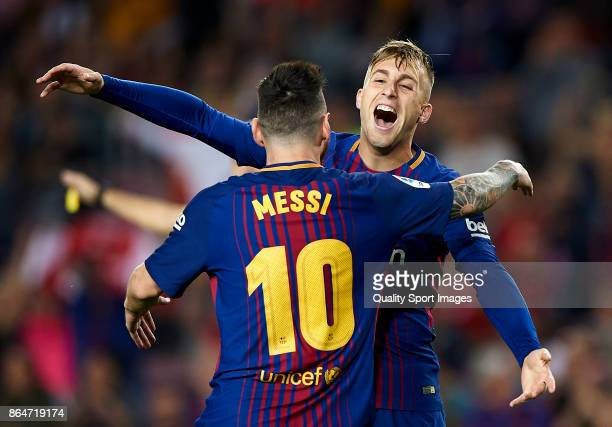 Gerard Deulofeu of Barcelona celebrates with Lionel Messi of Barcelona after scoring the first goal during the La Liga match between Barcelona and...