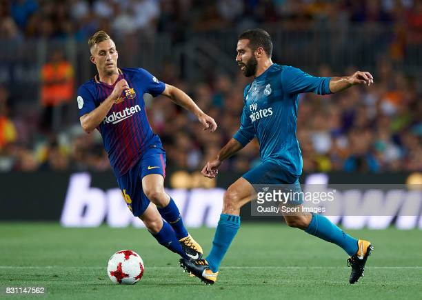 Gerard Deulofeu of Barcelona competes for the ball with Daniel Carvajal of Real Madrid during the Supercopa de Espana Supercopa Final 1st Leg match...