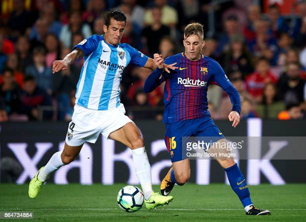 Gerard Deulofeu of Barcelona competes for the ball with Luis Hernandez Rodriguez of Malaga during the La Liga match between Barcelona and Malaga at...