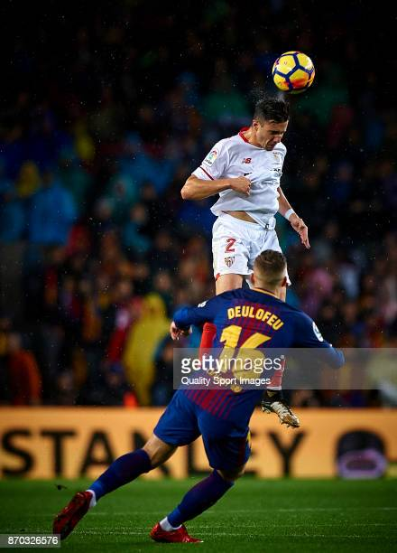 Gerard Deulofeu of Barcelona competes for the ball with Sebastien Corchia of Sevilla during the La Liga match between Barcelona and Sevilla at Camp...