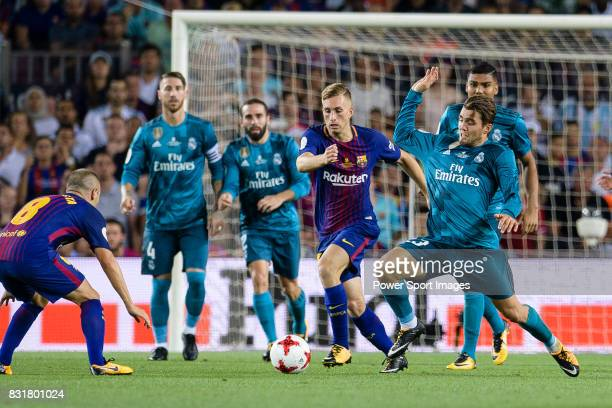 Gerard Deulofeu of Barcelona fights for the ball with Mateo Kovacic of Real Madrid during the Supercopa de Espana Final 1st Leg match between FC...