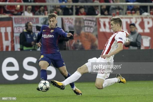 Gerard Deulofeu of Barcelona in action against Bjorn Engels of Olympiakos during a UEFA Champions League match between Olympiakos and Barcelona at...