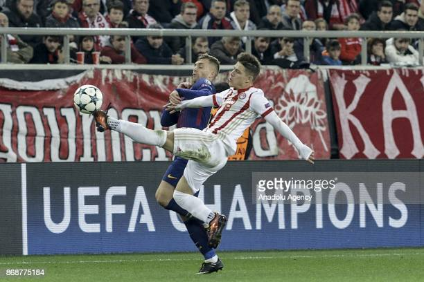 Gerard Deulofeu of Barcelona in action against Leonardo Koutris of Olympiakos during a UEFA Champions League match between Olympiakos and Barcelona...