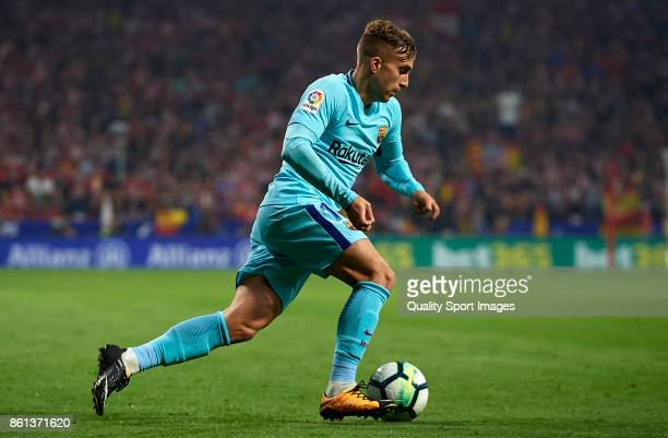 Gerard Deulofeu of Barcelona runs with the ball during the La Liga match between Atletico Madrid and Barcelona at Estadio Wanda Metropolitano on...