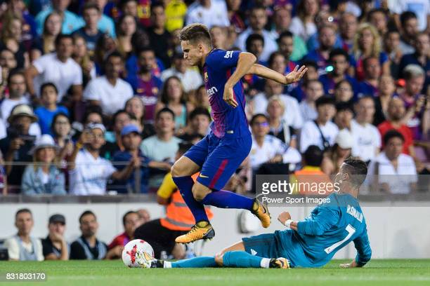 Gerard Deulofeu of Barcelona trips up with Cristiano Ronaldo of Real Madrid during the Supercopa de Espana Final 1st Leg match between FC Barcelona...