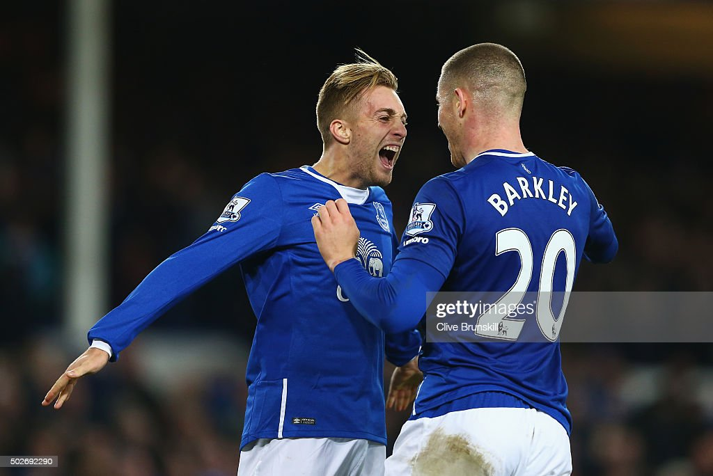 Gerard Deulofeu (L) of Everton celebrates scoring his team's third goal with his team mate Ross Barkley (R) during the Barclays Premier League match between Everton and Stoke City at Goodison Park on December 28, 2015 in Liverpool, England.
