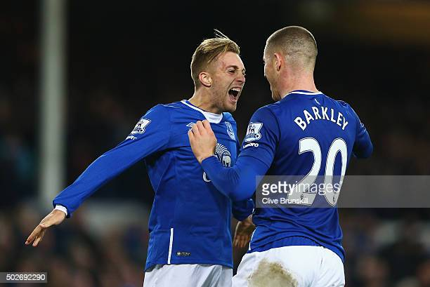 Gerard Deulofeu of Everton celebrates scoring his team's third goal with his team mate Ross Barkley during the Barclays Premier League match between...