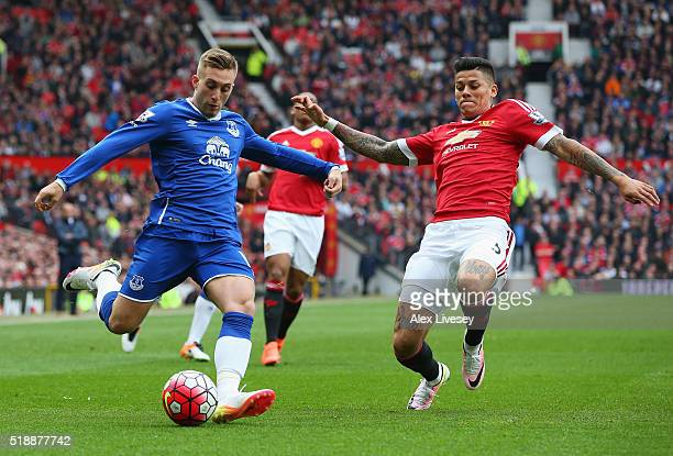 Gerard Deulofeu of Everton is blocked by Marcos Rojo of Manchester United during the Barclays Premier League match between Manchester United and...