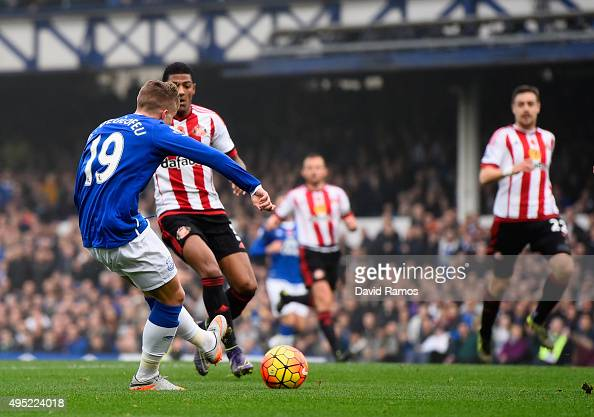 Gerard Deulofeu of Everton scores their first goal during the Barclays Premier League match between Everton and Sunderland at Goodison Park on...