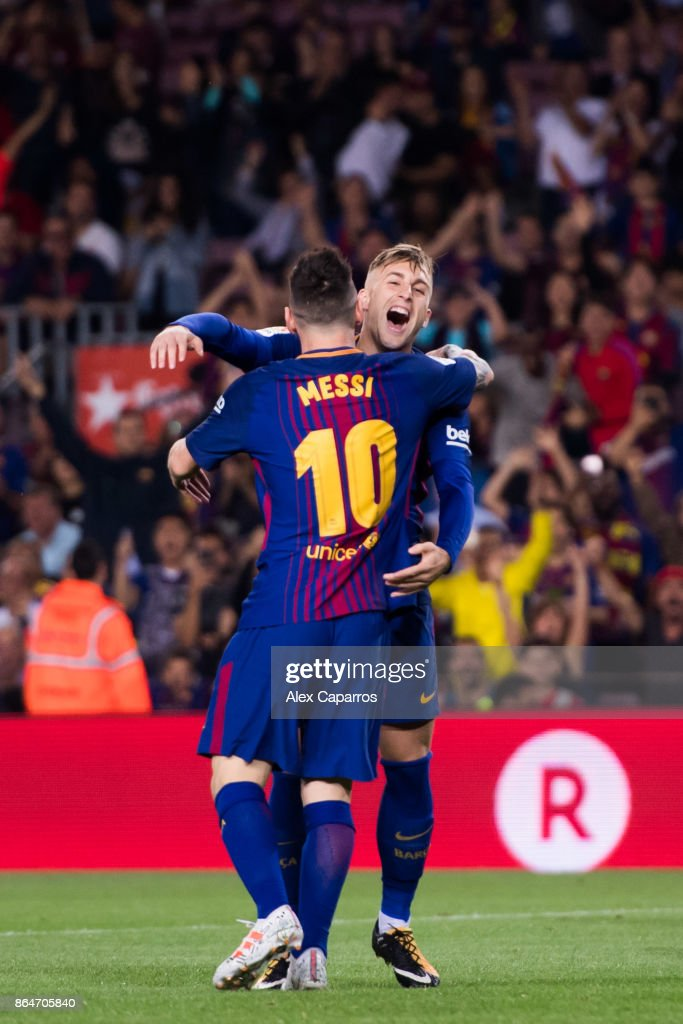 Gerard Deulofeu of FC Barcelona celebrates with his teammate Lionel Messi after scoring the opening goal during the La Liga match between Barcelona and Malaga at Camp Nou on October 21, 2017 in Barcelona, Spain.
