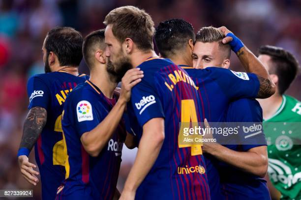 Gerard Deulofeu of FC Barcelona celebrates with his teammates after scoring the opening goal during the Joan Gamper Trophy match between FC Barcelona...