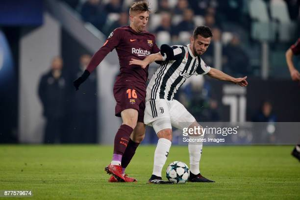 Gerard Deulofeu of FC Barcelona Miralem Pjanic of Juventus during the UEFA Champions League match between Juventus v FC Barcelona at the Allianz...