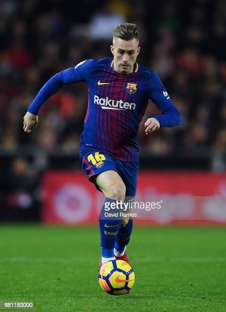 Gerard Deulofeu of FC Barcelona runs with the ball during the La Liga match between Valencia and Barcelona at Mestalla stadium on November 26 2017 in...