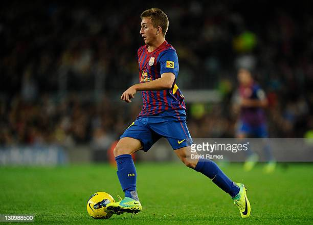 Gerard Deulofeu of FC Barcelona runs with the ball during the La Lliga match between FC Barcelona and RCD mallorca at Camp Nou on October 29 2011 in...
