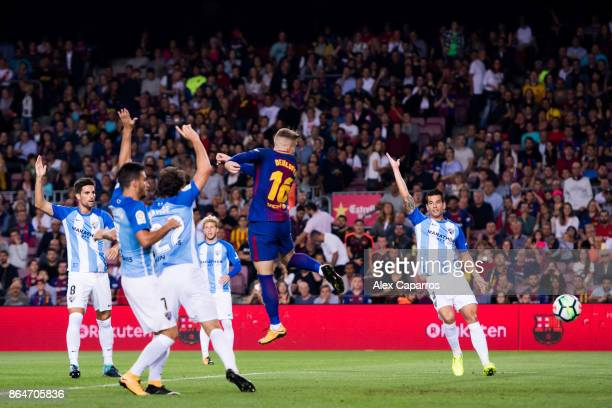 Gerard Deulofeu of FC Barcelona scores the opening goal during the La Liga match between Barcelona and Malaga at Camp Nou on October 21 2017 in...